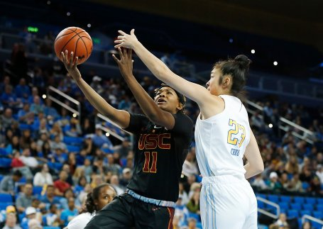 Natalie Chou defends Aliyah Jeune. Maria Noble/WomensHoopsWorld
