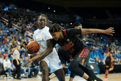 Aliyah Jeune tries to poke the ball away from Kayla Owens. Maria Noble/WomensHoopsWorld