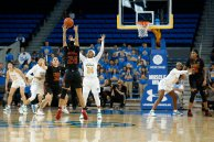 Desiree Caldwell passes the ball overhead. Maria Noble/WomensHoopsWorld