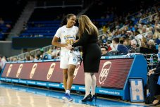 Coach Cori Close talks to Charisma Osborne as she checks out of the game for the last time. Maria Noble/WomensHoopsWorld
