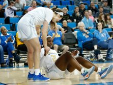 Lindsey Corsaro helps Michaela Onyenwere up after a foul. Maria Noble/WomensHoopsWorld.