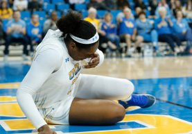 Lauryn Miller reacts after being hit in the face on a box out. Maria Noble/WomensHoopsWorld.