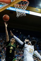 Satou Sabally lays the ball up and in. Maria Noble/WomensHoopsWorld.