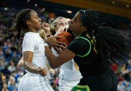Charisma Osborne and Ruthy Hebard fight for ball possession. Maria Noble/WomensHoopsWorld.
