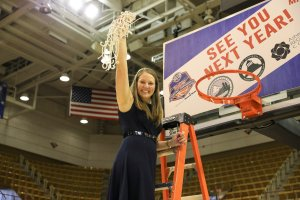 Carley Kuhns holds up the net after the Samford Bulldogs won the Southern Conference Tournament championship last month. Photo courtesy of Samford Athletics.