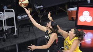 Dearica Hamby is defended by Stefanie Dolson. Phelan Ebenhack/AP Photo.