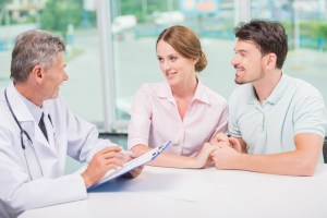 couple sitting in doctor's office at consultation