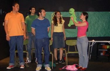 Green, felt puppet as Miss Folsom - Photo by Selene Santiago