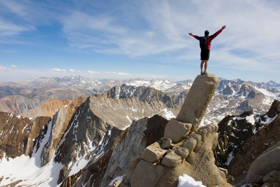 Victory salute on the mountain peak.