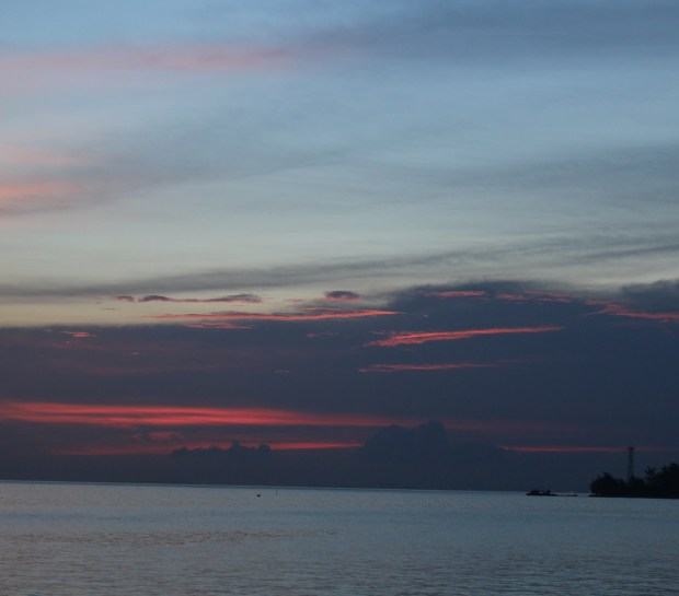 Sunset from the boat to Singapore Port