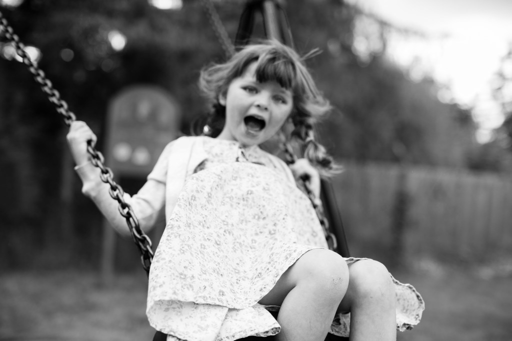 fun child swinging