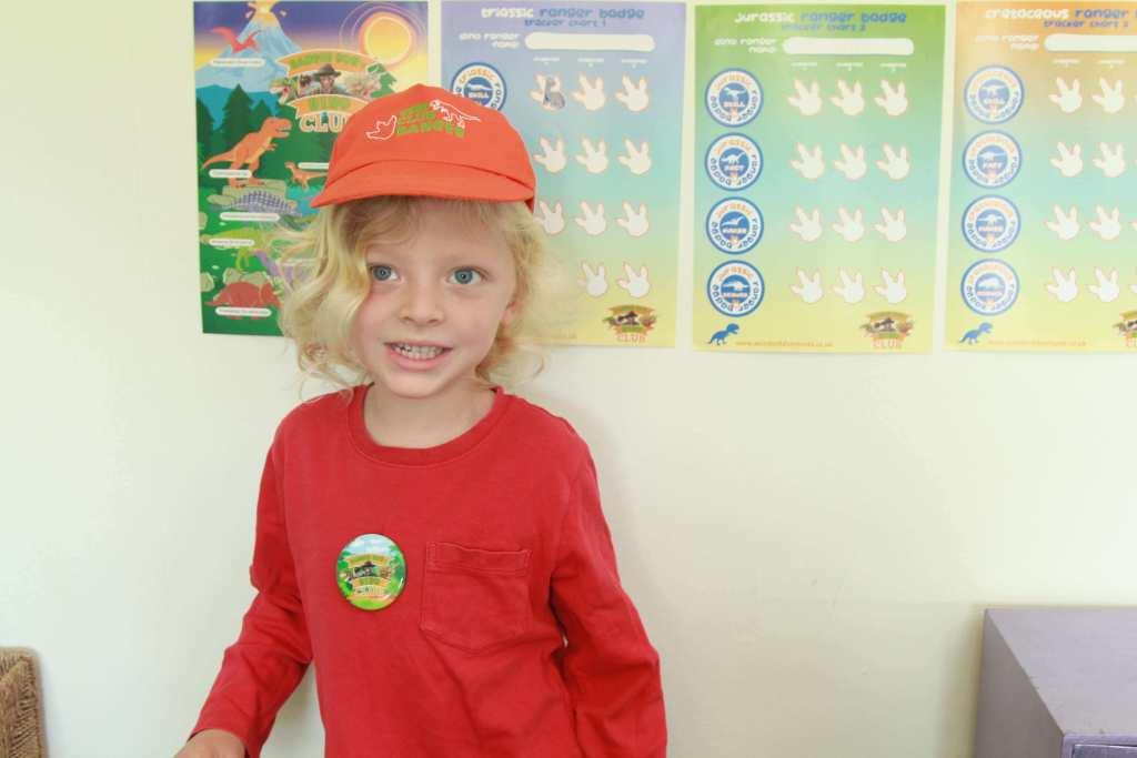 child with dinosaur badge chart