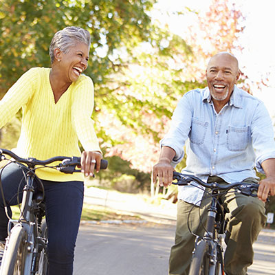 elderly couple on a bike