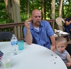 Uncle Craig and Garrett munching 1st dessert