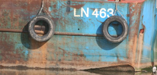 Close up of a boats number and detail, with rush and paint