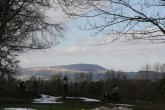 Pendle Hill in a little blanket of snow , golfers happily play a round despite the weather.