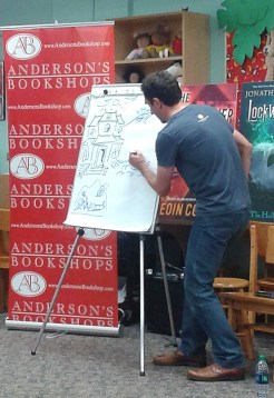 Stroud sketching some examples of traditional ghost haunts while explaining how he developed the premise for the Lockwood books.