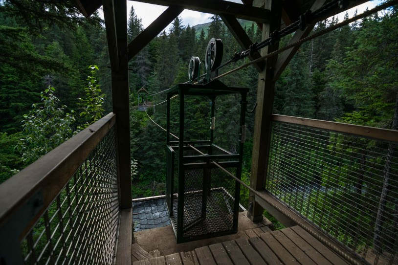 A hand powered cable car is is used to cross the winner creek river in Girdwoods Alaskan Rainforest.