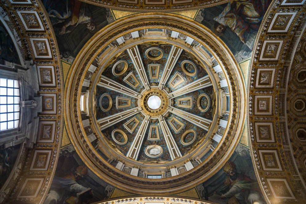 an interior view of one ceiling domes in St. Peter's Bascilica located in the vatican.