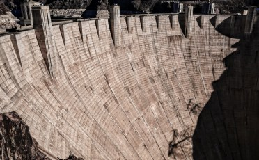 Dam with Shadows of Electrical Towers