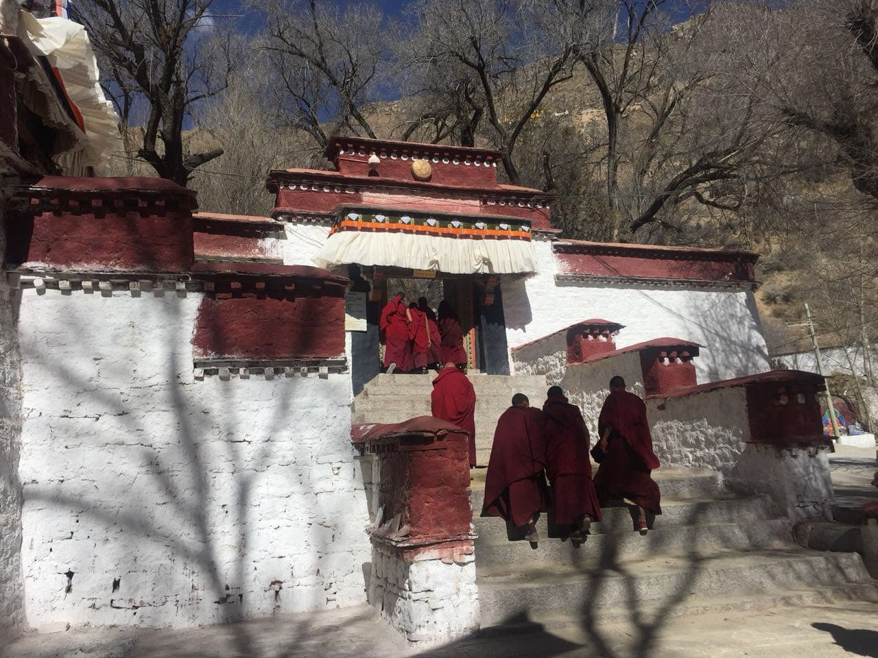 Monks walking to the Sera monastery in Tibet