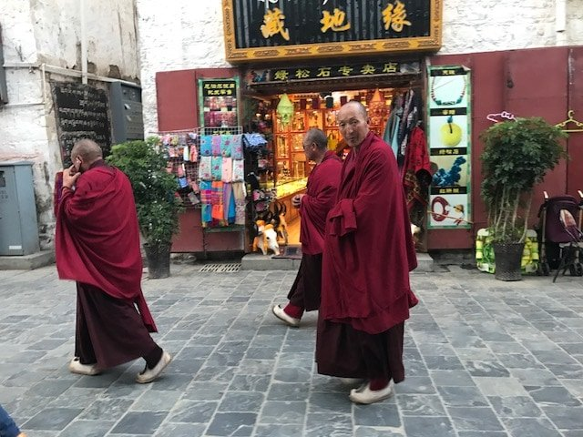 Monks walking on the Bakhor Street in Lhasa