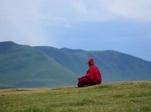 Tibetan monk meditating outside