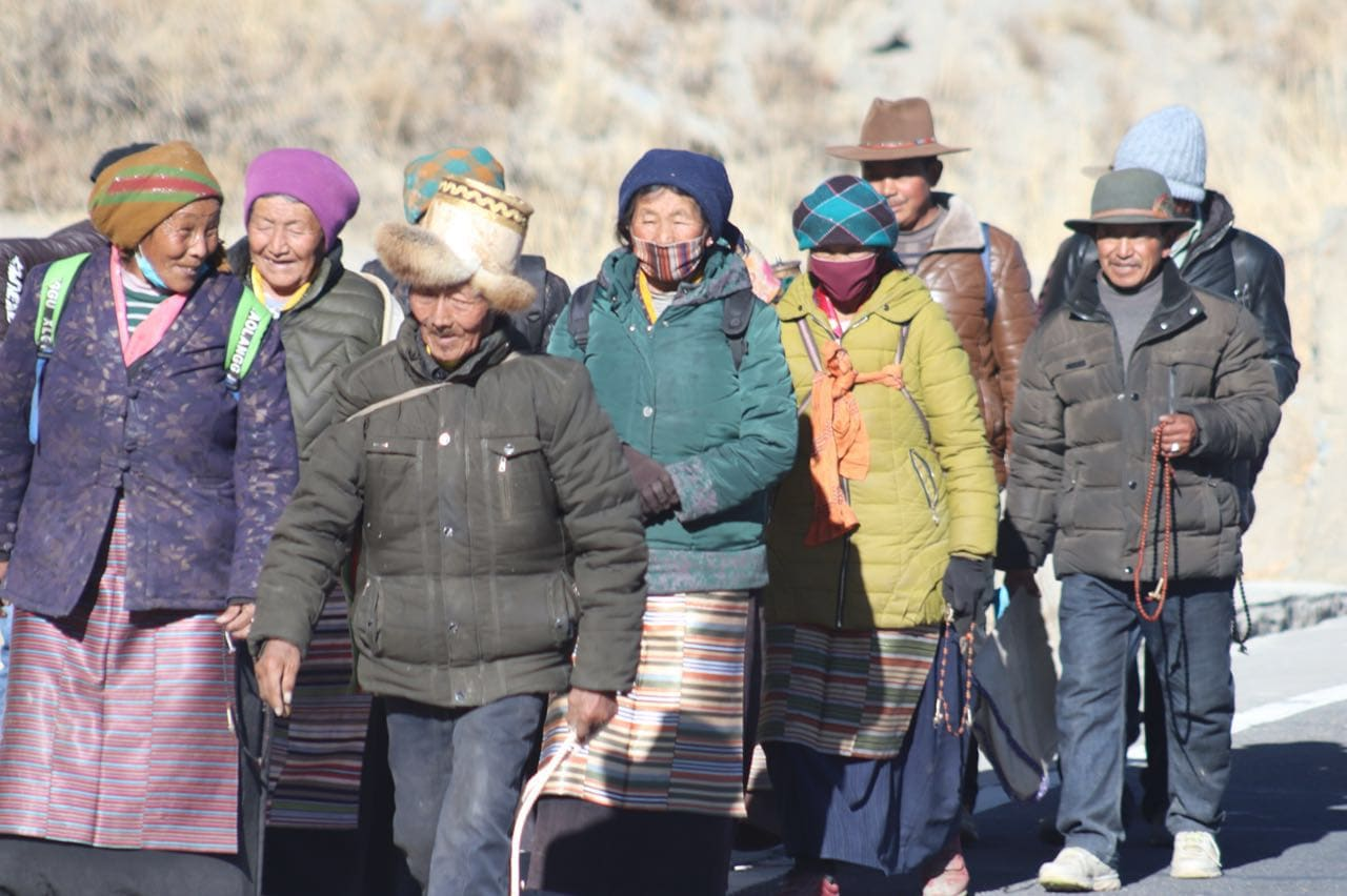 Tibetans walking along the road