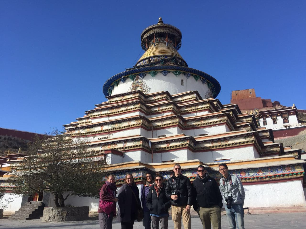 Group Tour stops by the Kumbum Stupa in Tibet