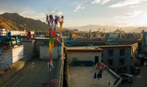 Sunrise over the houses in Lhasa, Tibet