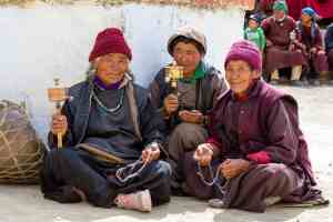 Tibetan women spinning prayer wheels