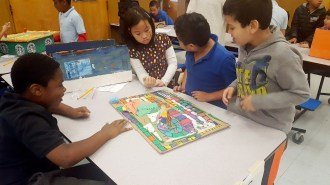 Students play a student created board game