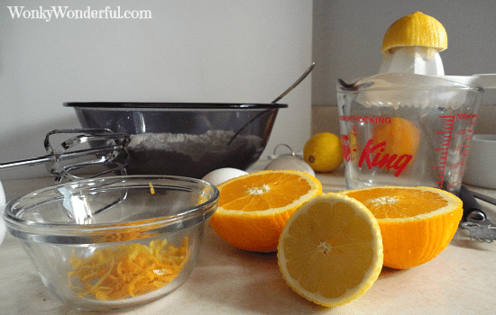 oranges being juiced and zested for cookies
