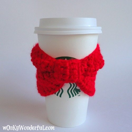 white Starbucks cup with bright red crocheted bow cup cozy