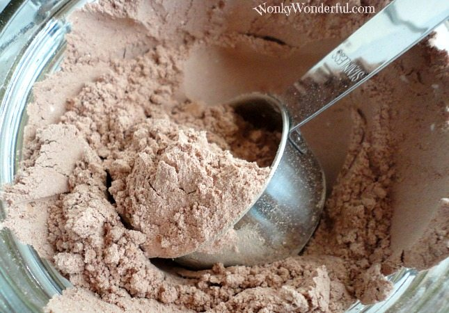 closeup of metal scoop in cocoa mix