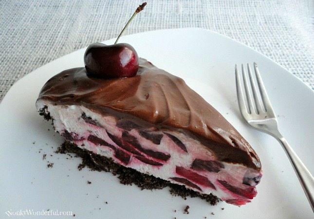 slice of chocolate cherry pie on white plate with fork