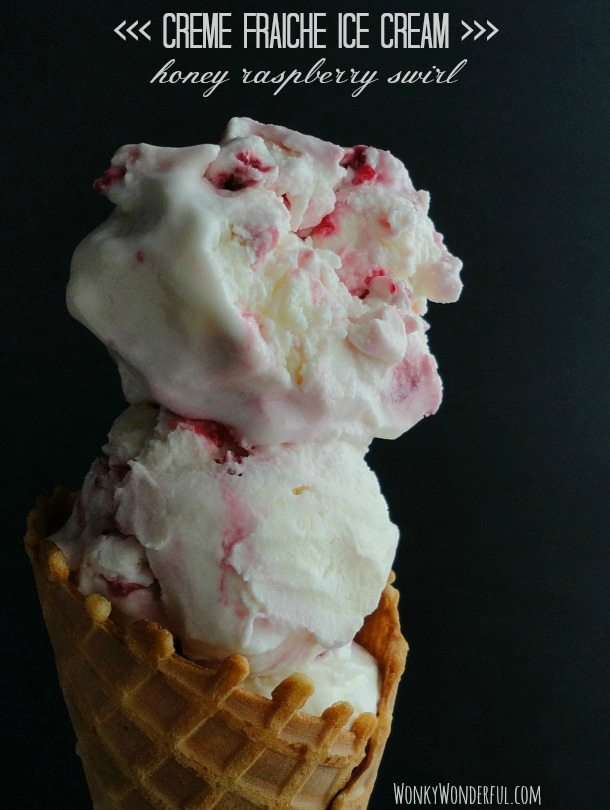 waffle cone filled with white ice cream with dark red ribbons - text: creme fraiche ice cream honey raspberry swirl