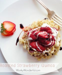 quinoa topped with roasted strawberries, balsamic glaze and creme fresh served on white plate