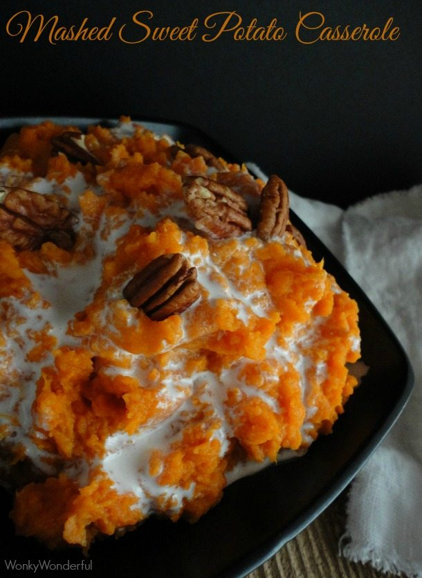 sweet potatoes marshmallow and pecans in black bowl - text: mashed sweet potato casserole