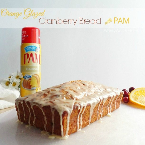 glazed loaf bread next to pam cooking spray - text: orange glazed cranberry bread with pam