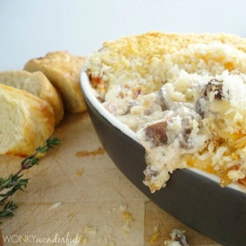 side photo of melty cheesy dip in black serving dish