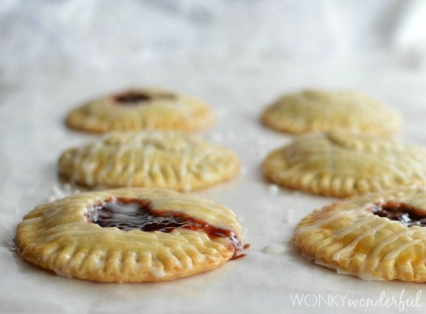 mini hand pies with heart shaped cut out on top