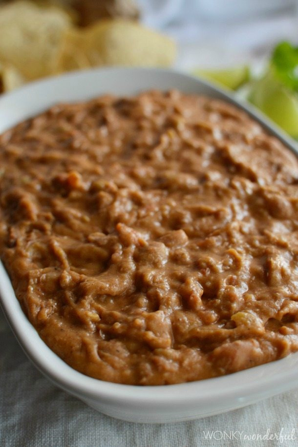 creamy pinto beans in white serving dish