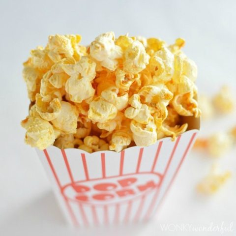 popcorn box filled with orange colored popcorn