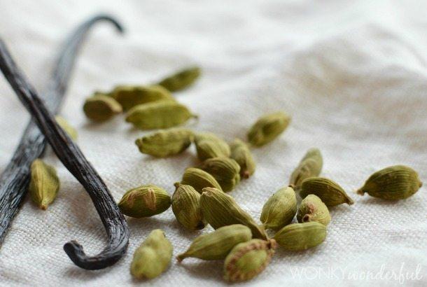 closeup of cardamom pods and vanilla bean