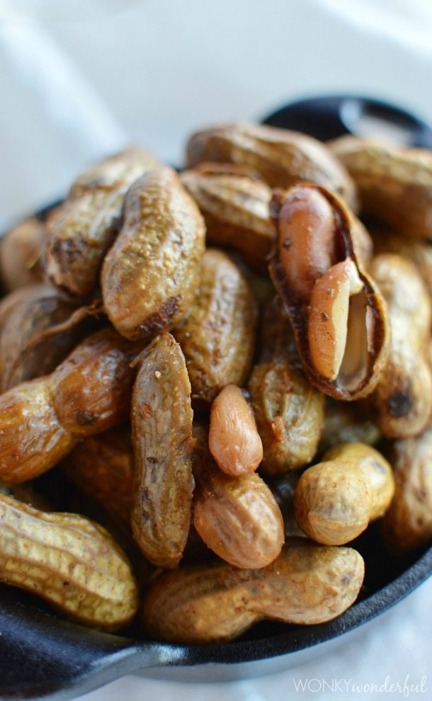 closeup of boiled peanuts with one cracked open