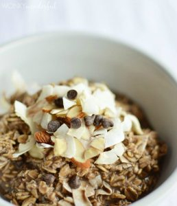brown oatmeal topped with almonds, coconut and chocolate chips