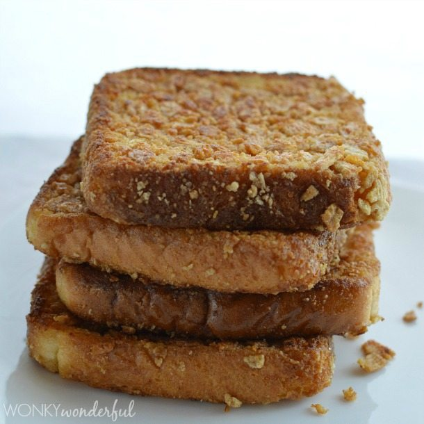stack of bread slices coated in crunchy cereal crumbs