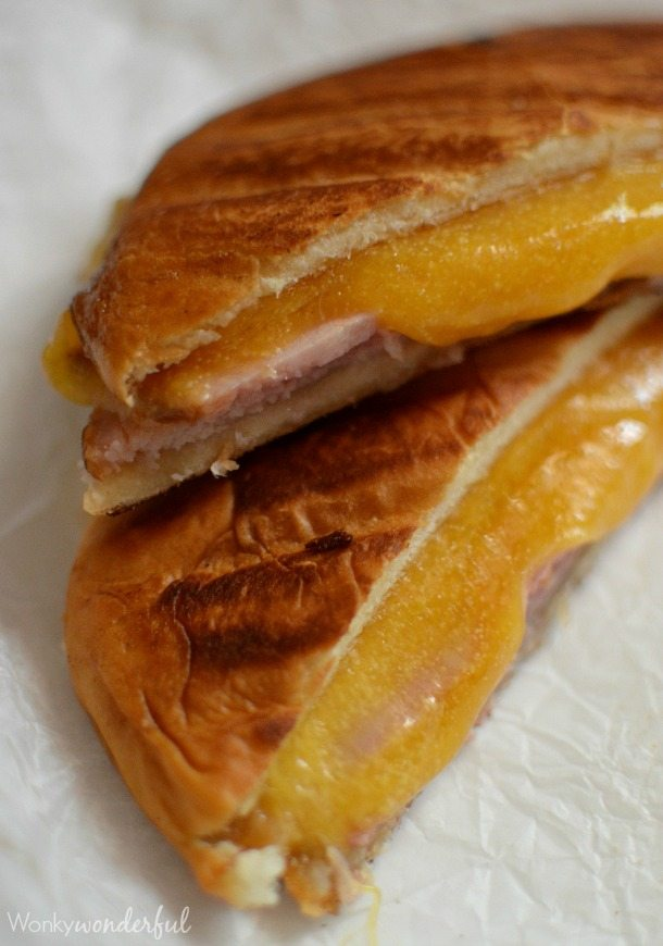 two halves of ham and cheese sandwich