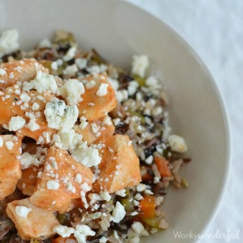 rice and veggies topped with chicken and blue cheese crumbles